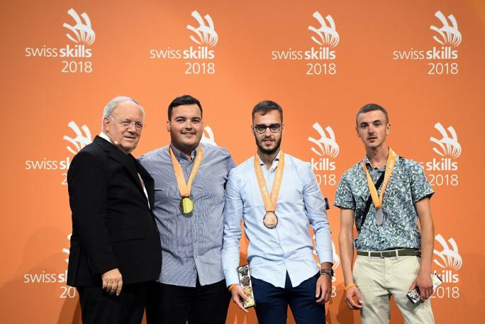Médaille de bronze pour Miguel Nelson Fernandes Ribeiro de Granges-Paccot (3e depuis la gauche)