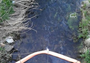 Pollution d'une rivière à Romont