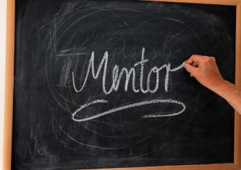 Mentor auf eine Tafel geschrieben
