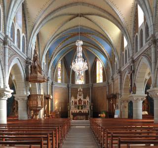 St-Loup-Kirche, in Le Crêt (La Verrerie), 1887-1889 nach Plänen des Pfarrers und Architekten Ambroise Villard erbaut.