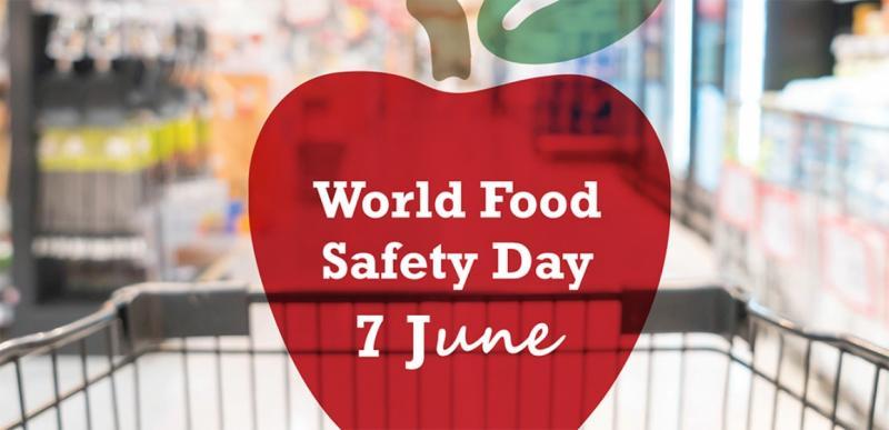 Das Bild zeigt das Logo für den Internationalen Tag der Lebensmittelsicherheit, ein roter Apfel